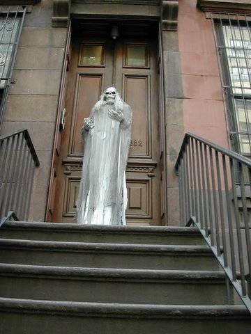 the white long ghost in front of the door at the most haunted house in my zip-code